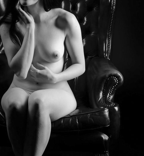Naked Girl Sitting On A Chair